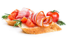 Canape with ham and tomato Royalty Free Stock Photography