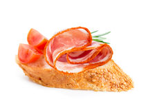 Canape with ham and tomato Stock Images