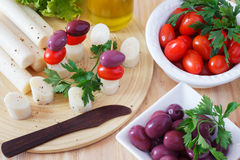 Canape of Heart of palm (palmito), cherry tomatos, olives Stock Images