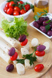 Canape of Heart of palm (palmito), cherry tomatos, olives Royalty Free Stock Photo