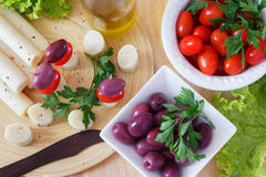 Canape of Heart of palm (palmito), cherry tomatos, olives Stock Image