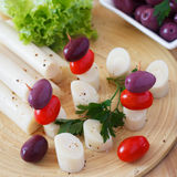 Canape of Heart of palm (palmito), cherry tomatos, olives Stock Photo