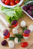 Canape of Heart of palm (palmito), cherry tomatos, olives Stock Photos