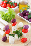Canape of Heart of palm (palmito), cherry tomatos, olives Royalty Free Stock Image