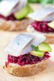 Canape herring with beets on rye toast, tasty starter, appertise Stock Photo