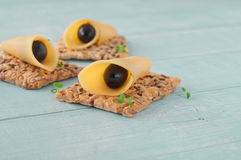 Canape made cookies with cheese and black olives Stock Images
