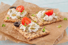 Canape made cookies with cheese, cherry tomatoes and black olive Royalty Free Stock Images