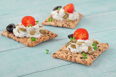 Canape made cookies with cheese, cherry tomatoes and black olive Stock Photos