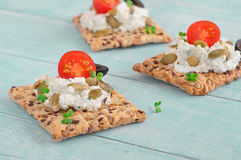 Canape made cookies with cheese, cherry tomatoes and black olive Stock Image