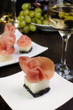 Canape melon in sesame with gammon Stock Image