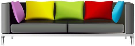 Canape mit fünf farbigen Kissen Stockbilder