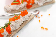 Canape from paste with caviar. Canape from paste from cod liver and cheese of a rikkot with caviar and greens Royalty Free Stock Images