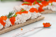 Canape from paste with caviar. Canape from paste from cod liver and cheese of a rikkot with caviar and greens Royalty Free Stock Photography