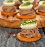 Canape with pate and egg Stock Image