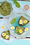 Canape with pesto and eggs Stock Image