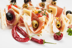 Canape with prosciutto and olives Stock Photography