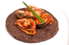 Canape with Pumpernickel and mussels Royalty Free Stock Photography