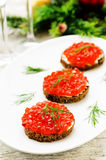 Canape with red caviar and cream cheese Stock Photos