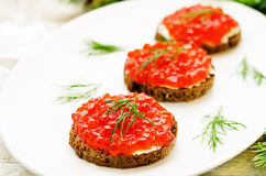 Canape with red caviar and cream cheese Royalty Free Stock Photos