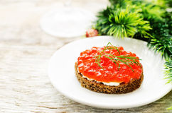 Canape with red caviar and cream cheese Stock Image