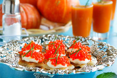 Canape with red caviar for party, Stock Photography