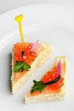 Canape with red caviar and smoked salmon Stock Photography