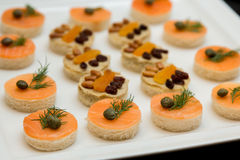 Canape with red fish and butter stock images