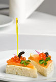 Canape with red kaviar and smoked salmon Stock Images