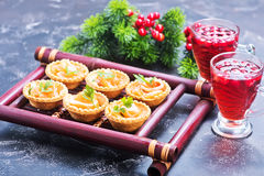 Canape. With red salmon on the bamboo tray royalty free stock images