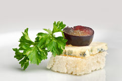 Canape with Roquefort cheese. And grape berry Stock Images