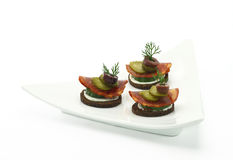 Canape with salami. And vegetables royalty free stock photography
