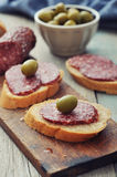 Canape with salami Royalty Free Stock Photography