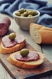 Canape with salami Royalty Free Stock Image