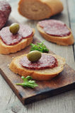 Canape with salami Royalty Free Stock Images