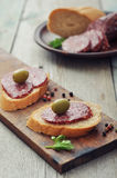 Canape with salami Stock Photo