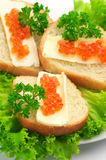 Canape with salmon caviar Stock Photos