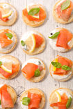 Canape with salmon Stock Photos