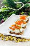 Canape with salmon and cream cheese with dill Stock Photos