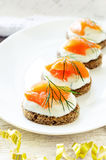 Canape with salmon and cream cheese with dill Royalty Free Stock Image