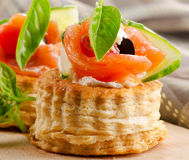 Canape with salmon. Cream cheese and vegetables. Selective focus royalty free stock photo