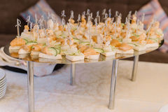Canape with salmon and cucumber on skewers with cheese royalty free stock image