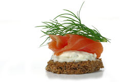 Canape with salmon and dill garnish, isolated on white backgrou Royalty Free Stock Images