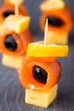 Canape with salmon and olive Stock Photo