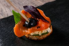 Canape with salmon. And salad leaves Stock Photo