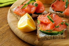 Canape sandwiches with salmon Stock Photo