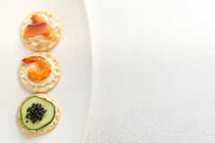 Canape with seafood on the plate Stock Photos