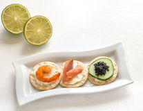 Canape with seafood on the plate Royalty Free Stock Images