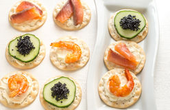 Canape with seafood on the plate Stock Image