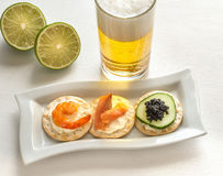 Canape with seafood on the plate Stock Photography