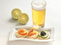 Canape with seafood on the plate Stock Images